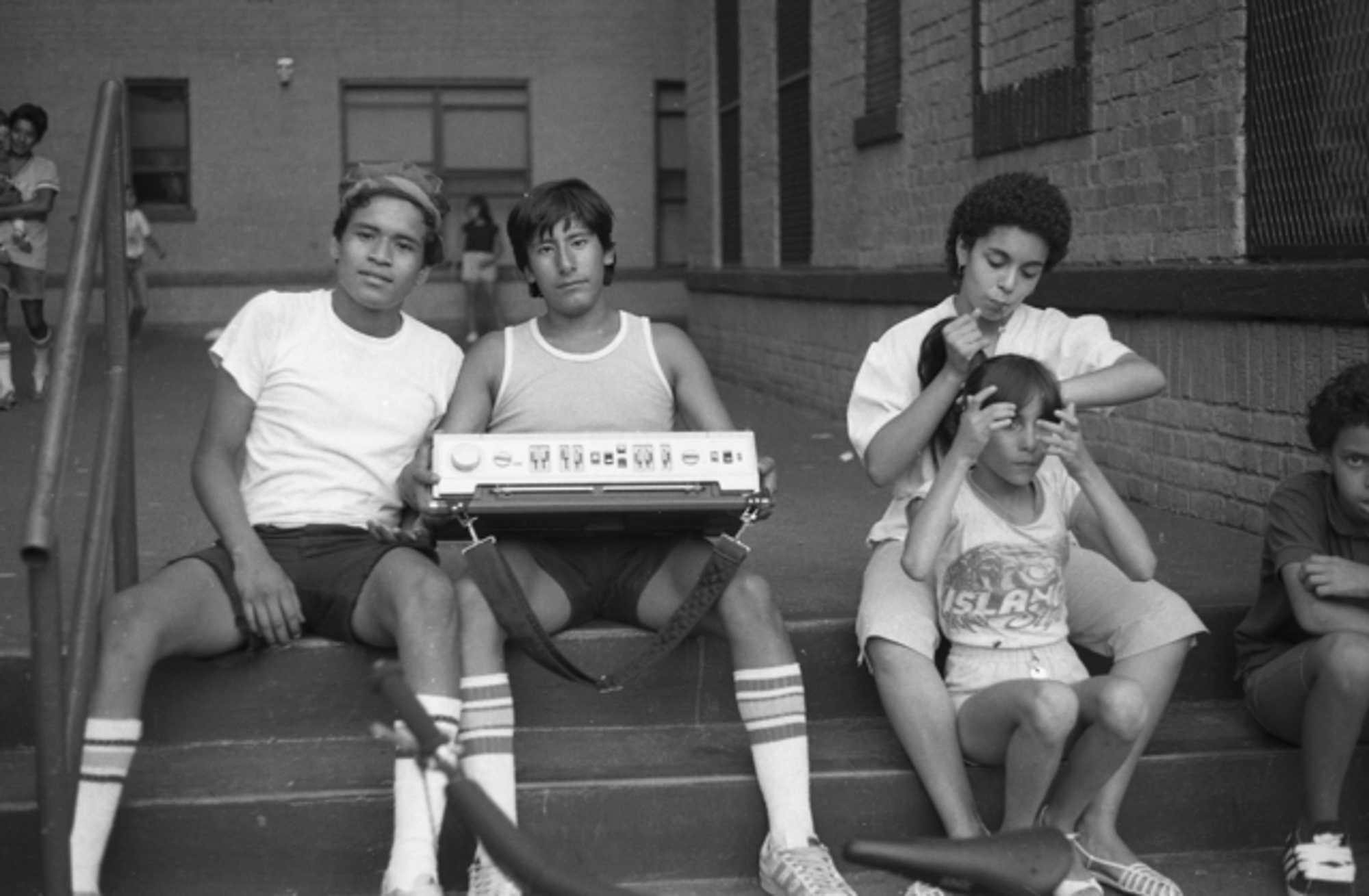 Hanging out on the stoop, South Bronx, 1983.  Photo by Ricky Flores