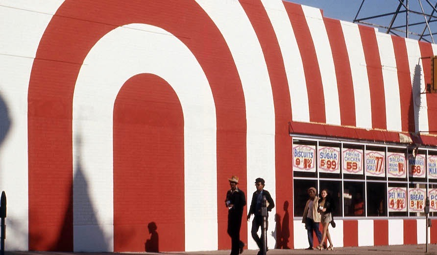 red_and_white_striped_storefront_with_passersby_attrib_to_arthur_stross_around_1970 22