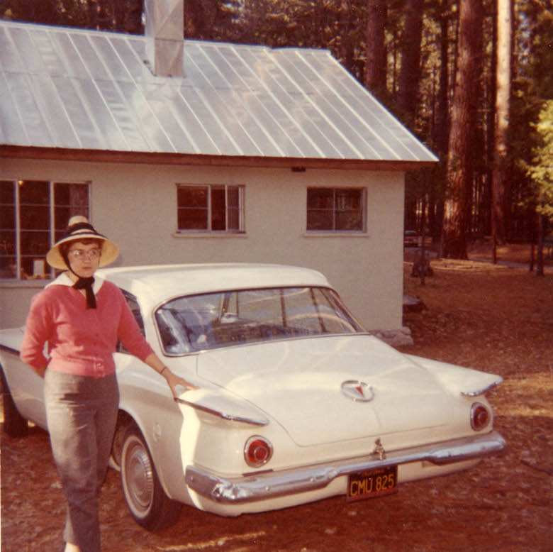 untitled_portrait_of_a_woman_in_a_pink_sweater_with_a_white_automobile_unknown_photographer_around_1950-60